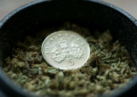 A coin in a grinder