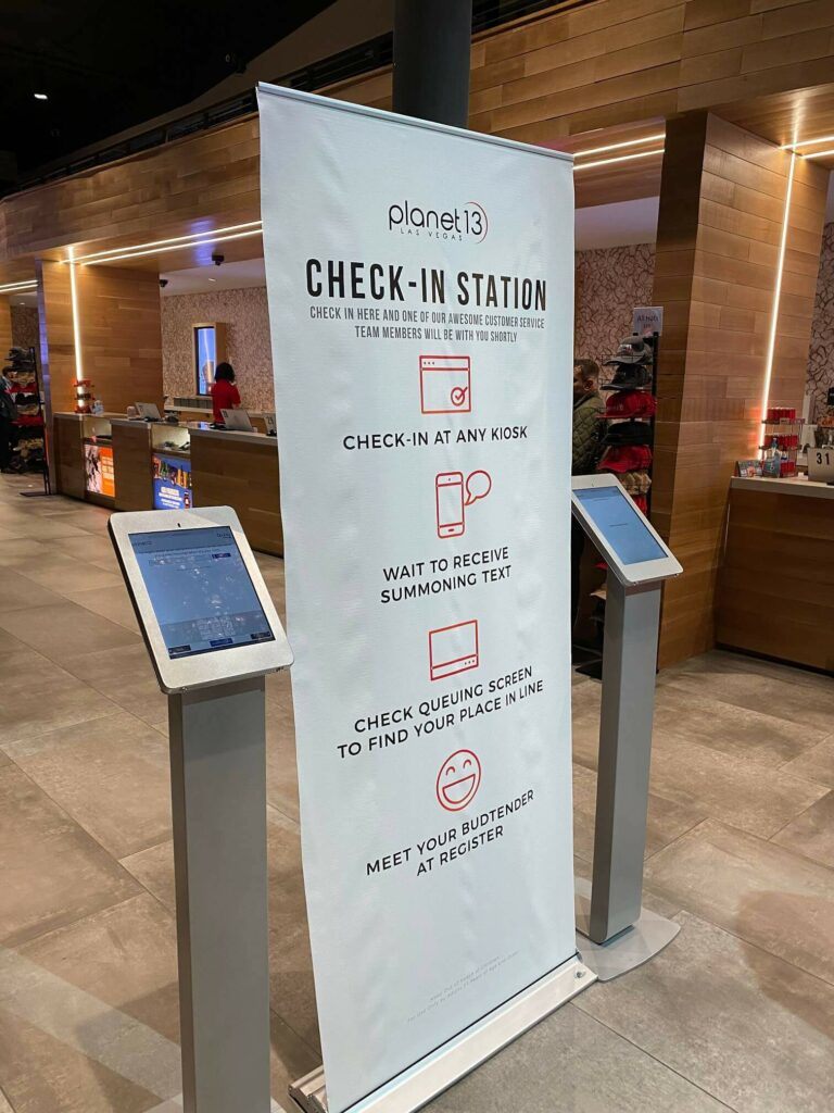 Two check-in stations at the Planet 13 dispensary in Las Vegas