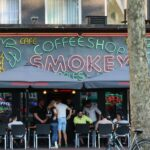 People relaxing in front of Smokey coffeeshop in Amsterdam