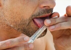 A man licking a joint